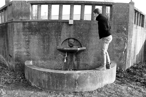 My friend standing on the old fountain in Downingtown. I barely remember the last time they had it running.